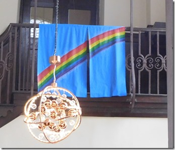 2 rainbow flag in cathedral