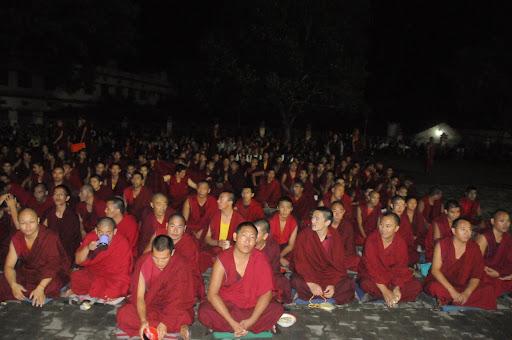 Monks doing prayers outside