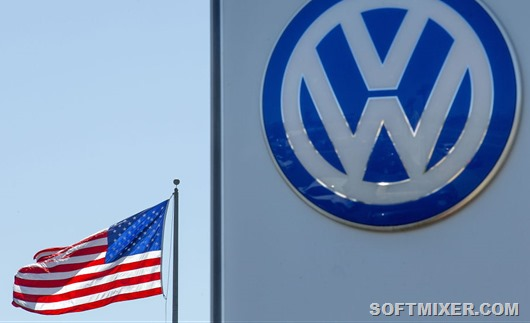 An_American_flag_flies_next_to_a_Volkswagen_car_dealership_in_Sa