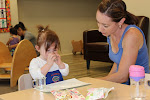 Snack time at the Infant Parent & Child Montessori class is self-initiated with independence being supported by offering real glasses to drink from.