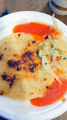 Portland Mercado has 8 carts in their food cart pod, where each food cart specializes in different Latin cuisine. The cart 5 Volcanes specializes in pupusas and empanadas which are typical Salvadorian dishes - here you see a pupusa