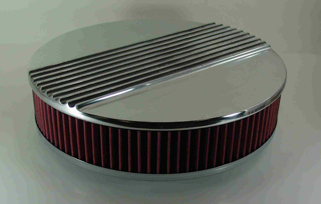 "14 3/8"" round air cleaner, cotton gaze filter for 5 1/8 neck 4 barrels, 4 1/4"" tall. Polished cast aluminum. 185.00"