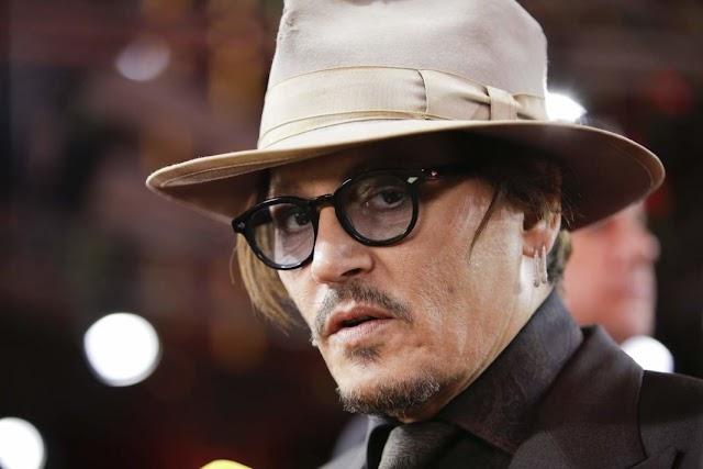 Johnny Depp tem relação conturbada com ator de Animais Fantásticos