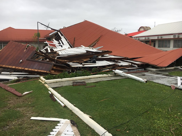 This image made from a video, shows the Parliament House destroyed by Cyclone Gita in Nuku'alofa, Tonga on 12 February 2018. Photo: Michael Morra / Twitter