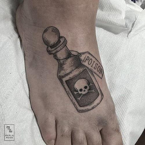 este_veneno_em_uma_garrafa_de_aviso