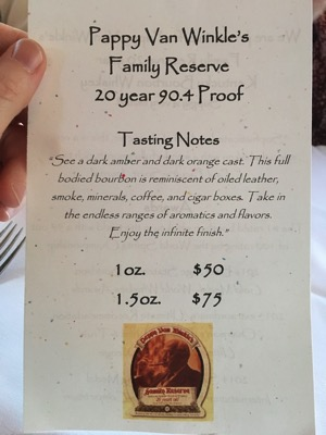A card displaying tasting prices for Pappy Van Winkle bourbon