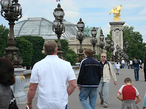 Walking across the bridge toward Le Grand Palais