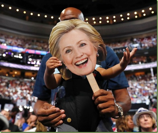 hillary face on a stick