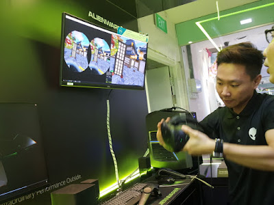 Visitors can try out virtual reality gaming at the Alienware section with the HTC Vive. Fruit Ninja for VR is displayed.