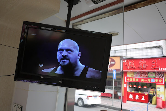 U.S. professional wrester on a TV screen in Changsha, China.