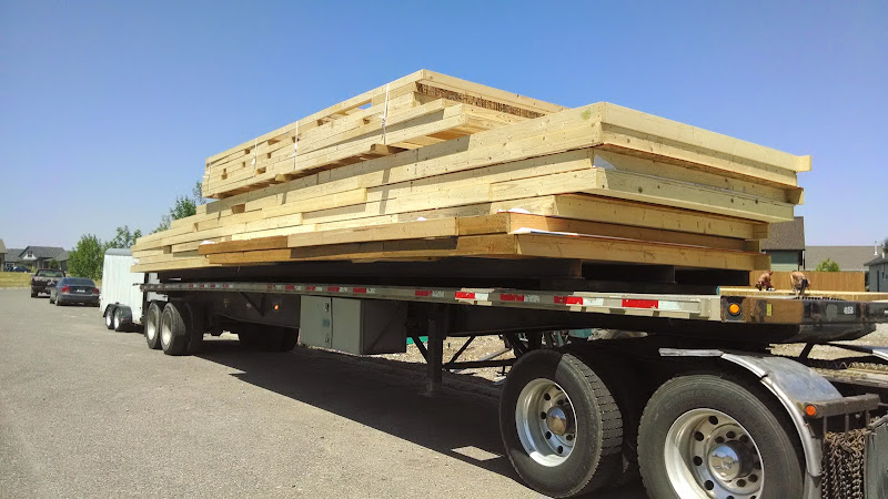 oversized flatbed trailer loaded with construction materials