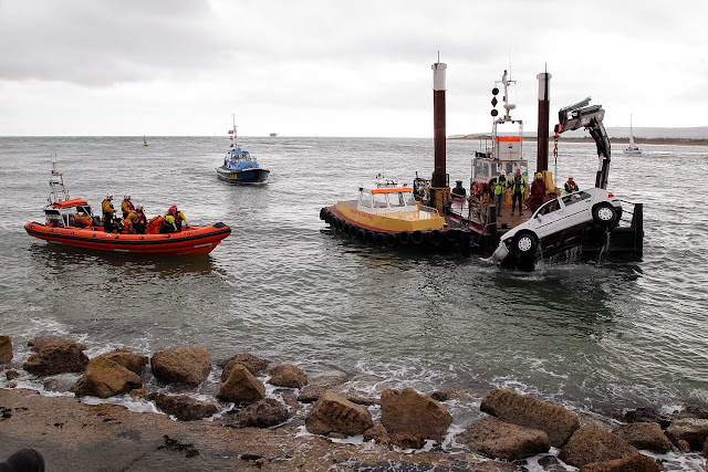 Poole ILB stands by as the submerged vehicle is lifted out by a Jenkins Marine crane - 27 October 2014.  Photo credit: Sally Adams/Bournemouth Echo