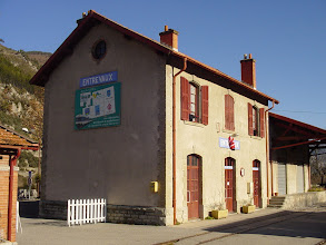 Photo: The train station is typical of small-town France. The hanging Santa is very popular, and we see them in many places.