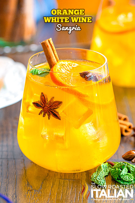 White wine sangria with orange juice in a glass