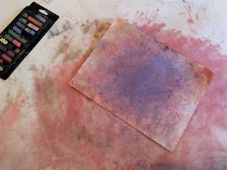 A chalk drawing with chalk powder smudged everywhere