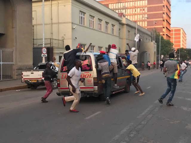 Celebration breaks out on the streets of Zimbabwe as Mugabe finally resigns after 37 years in power