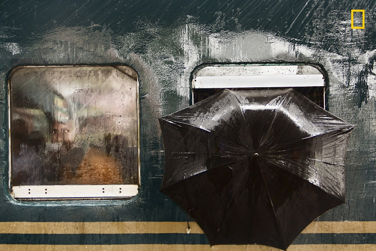 'The Man's State', which was taken at the Tongi Railway Station in Gazipur, Bangladesh, got an Honorable Mention in the People Category.