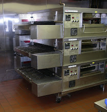 Photo: Triple stack Middle-Bee marshall oven I use that bake more pies faster then Ocean city can eat!!!!!!  I only have to turn on the 3rd bottom oven on Fridays and Saturdays in the summer!  I HAVE A VERY CLEAN OVEN HUH? I COMPLETELY  DISSASEMBLE IT EVERY MAY, TO WASH AND SHINE IT BACK TO NEW!  COME TO PINO`S AND ASK FOR THE 2 MINUTE NICKLE TOUR,  AND I`LL SHOW YOU EXACTLY HOW WE MAKE YOUR PIZZA STEP BY STEP.  This triple staclk beast cranks them out wonderfully---and a heck of allot faster then we can make em!