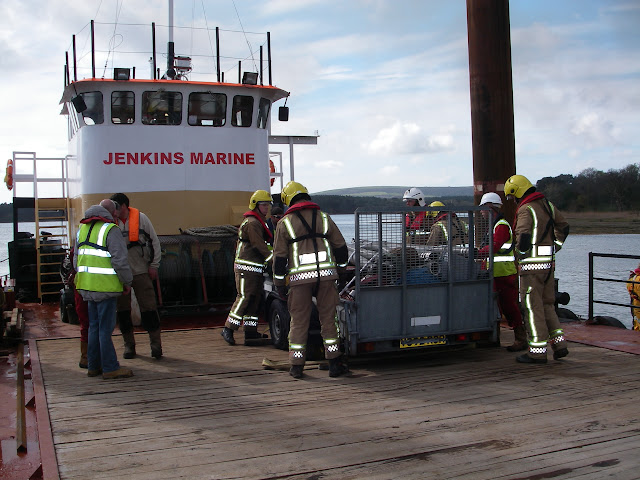 20 April 2012 - More equipment arrives on Jenkins Marine barge for take onto Green Island to fight the huge fire at a four-storey property. Photo: RNLI/Poole Lifeboat Station Anne Millman