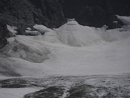 Look for a large boulder in the snowfield at about 10pm from center. I saw that vw sized boulder get hurled out there from above, so happy no one was below. Lots of stuff moving out there.