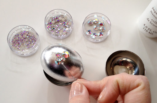 A sewing pin is great for applying and spreading your glue. This helps control the amount of glue needed for the specific size rhinestone and prevents any overflow.