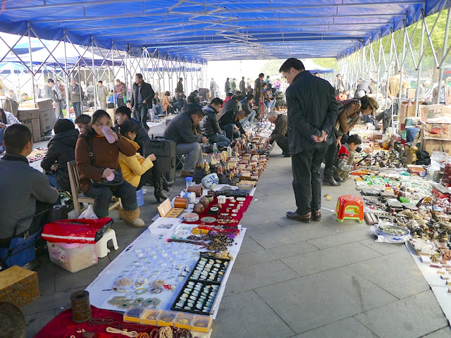 various sellers at an outdoor antique market in Changsha, China