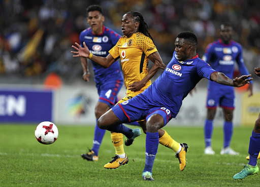 SuperSport United defender Morgan Gould (in blue) clears the ball from Siphiwe Tshabalala of Kaizer Chiefs during the cup quarterfinals in Durban yesterdayPicture: Gallo Images