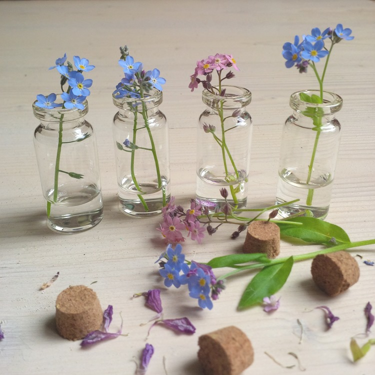 mini flowers in mini bottles
