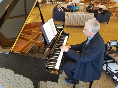 Claude Moffat playing the Kohler grand piano