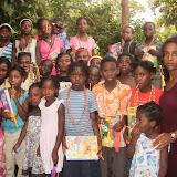 Haitian children making jewelry