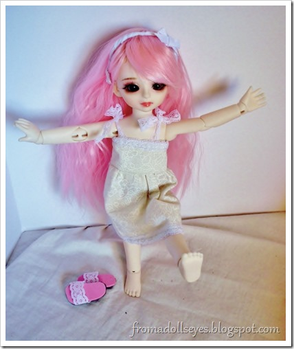 A ball jointed doll enjoying bare feet.