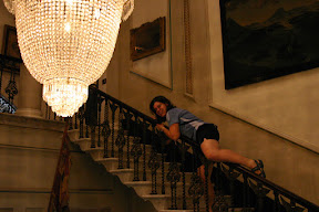 Laura sliding down a banister in Westport House