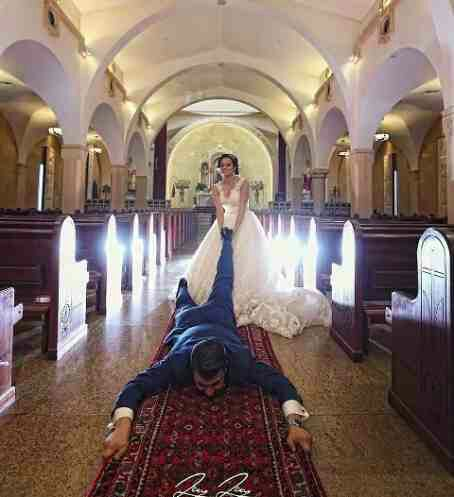Photo Of A Bride Dragging Her Man On The Floor