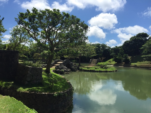 The pond in the middle of Shikina-en Royal Gardens is filled with koi carp and surrounded by old stone bridges and the royal holiday home