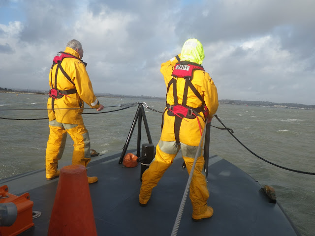 Two ALB crew members on deck in Poole Bay. 7 January 2014.  Photo credit: Anne Millman, RNLI Poole.