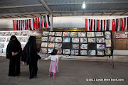 Gruesome photos of the dead and wounded are prominently displayed in front of the field hospital converted from a mosque. Change Square, Sana'a, Yemen. ساحة التغيير بصنعاء اليمن