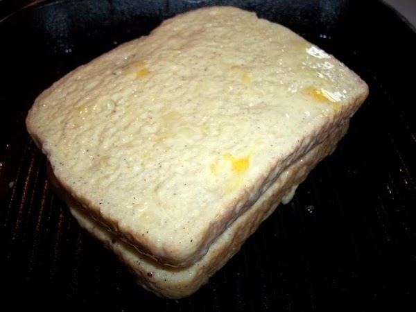 Soak other slice of bread now and place on top of banana's.
