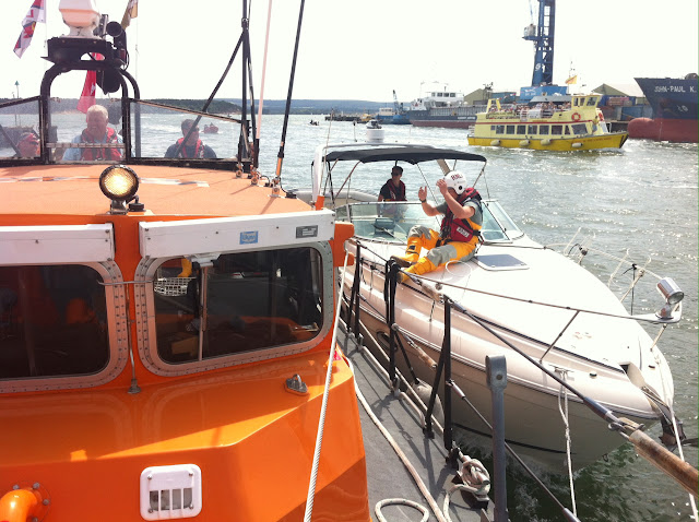 The ALB brings the cabin cruiser alongside Poole Quay - 18 July 2015.  Photo credit: Dave Riley