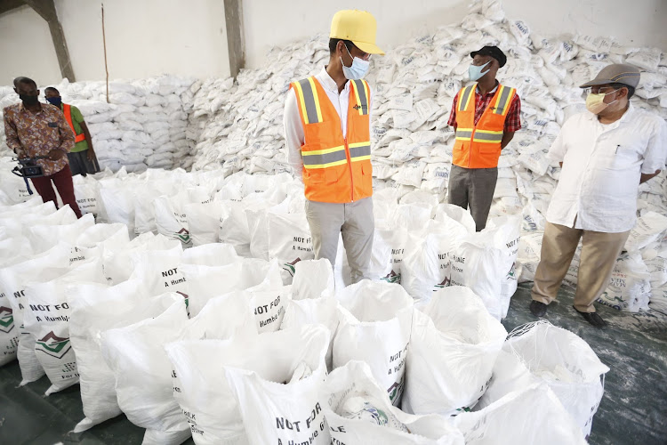 Jaffar Foundation director Solomon Ondego and CEO Yusuf Jiwa supervise the packaging of 20,000 bags of food at their warehouse in Shimanzi