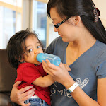 LePort Private School Irvine - Montessori teacher feeding baby at Irvine daycare