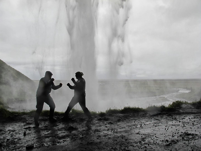 Fistfight behind Seljalandsfoss waterfall.