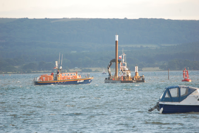 8 August 2011 - Poole's Tyne class all-weather lifeboat at the scene of the sinking of a J22 racing yacht, near the entrance to Poole Harbour