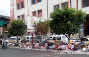 A strike by garbage collectors and street cleaner has left Sana'a buried in trash for over two weeks. People have resorted to dumping trash in the center divide outside Al Kumaim Center on Hadda street, Sana'a, Yemen