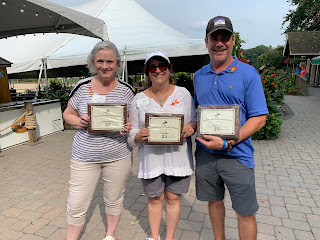 Corcoran Management Company employees posing with their 25 year plaques at Kimball Farm