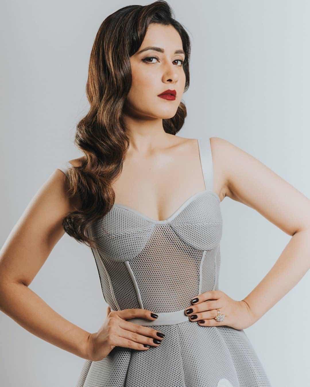 Raasi Khanna latest netted dress photo shoot Navel Queens