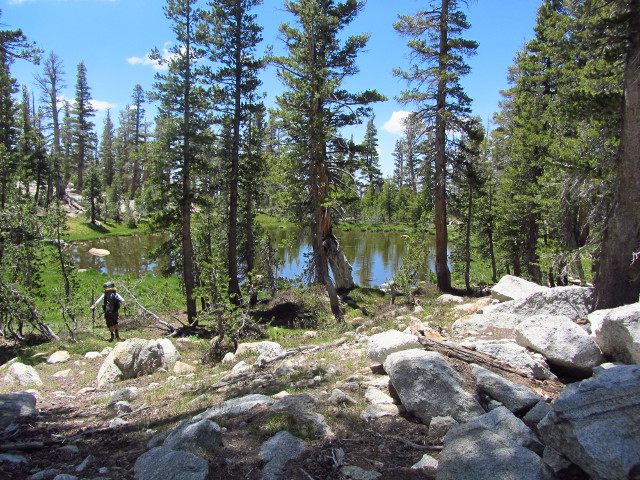 hiking down and past the little pond on the ridge