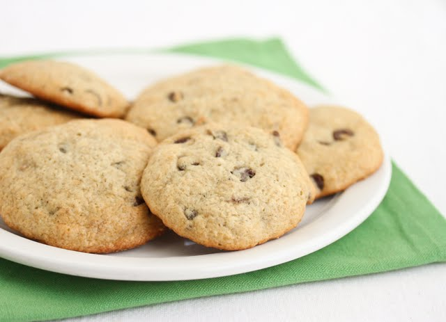 cookies piled on a white plate on a green napkin.
