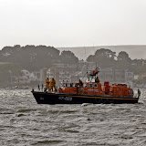 The ALB with the towline streaming out the bow leading to the grounded yacht in Whitley Lake, Poole Harbour - 27 October 2013.  Photo credit: Mike Millard