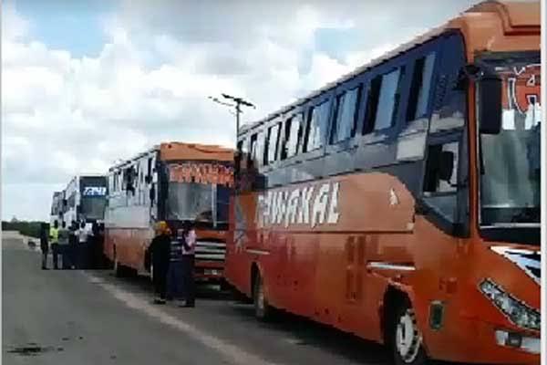 Tawakal buses heading to Lamu from Mombasa at Gamba police barrier.  PHOTO | NMG