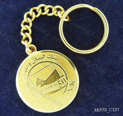 Silver or gold plated minted brass medal 30~40 mm in diameter ordered as a promotional corporate gift item.